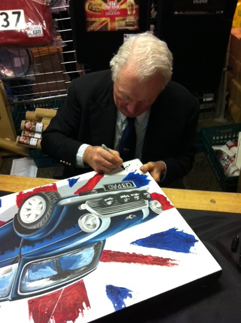 Paddy Hopkirk signing painting